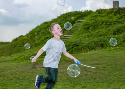 Stuart Bailey Media_Boy chasing bubbles