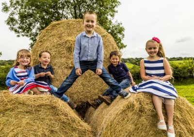 Stuart Bailey Media_Kids on hay Bales