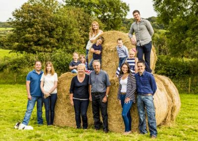 Stuart Bailey Media_Family by hay bales